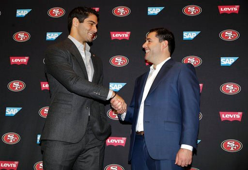 (AP Photo/Marcio Jose Sanchez). San Francisco 49ers quarterback Jimmy Garoppolo, left, shakes hands with owner Jed York after an NFL football press conference Friday, Feb. 9, 2018, in Santa Clara, Calif. Garoppolo has signed a five-year contract with t...