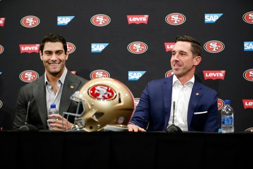 (AP Photo/Marcio Jose Sanchez). San Francisco 49ers quarterback Jimmy Garoppolo, left, smiles next to head coach Kyle Shanahan during an NFL football press conference Friday, Feb. 9, 2018, in Santa Clara, Calif. Garoppolo has signed a five-year contrac...