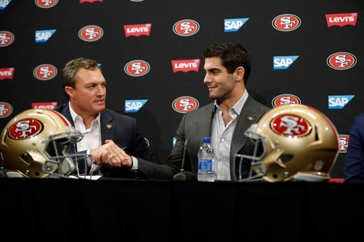 (AP Photo/Marcio Jose Sanchez). San Francisco 49ers quarterback Jimmy Garoppolo, right, shakes hands with general manager John Lynch during an NFL football press conference Friday, Feb. 9, 2018, in Santa Clara, Calif. Garoppolo has signed a five-year c...