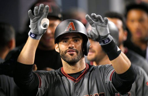 (AP Photo/Mark J. Terrill, File). FIL - In this Sept. 4, 2017, file photo, Arizona Diamondbacks' J.D. Martinez gestures toward the camera as he stands in the dugout after hitting his fourth home run of the game in the ninth inning of a baseball game ag...