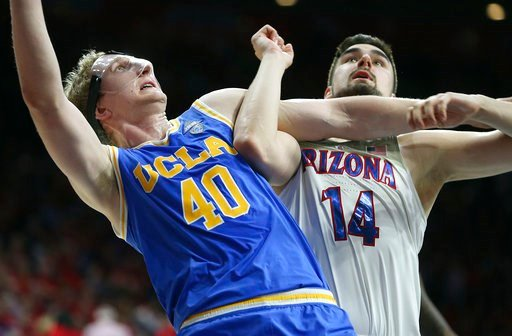 (AP Photo/Ralph Freso). UCLA center Thomas Welsh (40) and Arizona's Dusan Ristic (14) wait for a rebound during the second half of an NCAA college basketball game Thursday, Feb. 8, 2018, in Tucson, Ariz. UCLA defeated Arizona 82-74.
