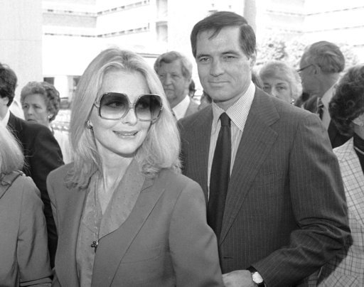 (AP Photo/Lennox McLendon, File). FILE - In this May 3, 1981 file photo, John Gavin and his wife Constance arrive for a memorial service for Jules Stein in Los Angeles.