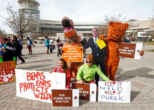 (AP Photo/Rick Bowmer). People gather to stand in support of Bears Ears and Grand Staircase-Escalante National Monuments on the day Interior Secretary Ryan Zinke is speaking during a conservation and hunting expo Friday, Feb. 9, 2018, in Salt Lake City...