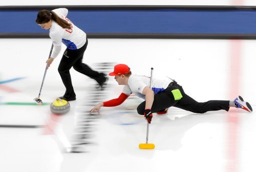 (AP Photo/Natacha Pisarenko). United States' Matt Hamilton throws a stone, right, as his sister and teammate Becca sweeps the ice during a mixed doubles curling match against China's Wang Rui and Ba Dexin at the 2018 Winter Olympics in Gangneung, South...