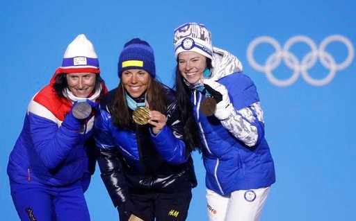 (AP Photo/Morry Gash). Women's cross-country 7.5/7.5km skiathlon medalists from left Norway's Marit Bjoergen, silver, Sweden's Charlotte Kalla, gold, and Finland's Krista Parmakoski, bronze, pose during their medals ceremony at the 2018 Winter Olympics...