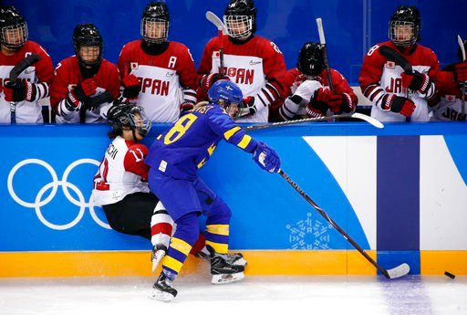 (AP Photo/Jae C. Hong). Anna Borgqvist (18), of Sweden, checks Yurie Adachi (11), of Japan, during the third period of the preliminary round of the women's hockey game at the 2018 Winter Olympics in Gangneung, South Korea, Saturday, Feb. 10, 2018.
