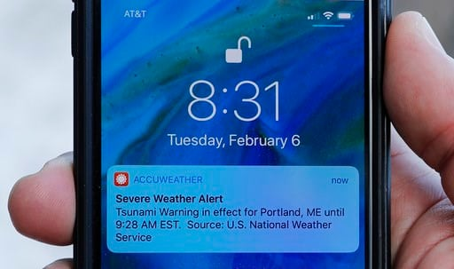 (AP Photo/Robert F. Bukaty). In this Thursday, Feb. 8, 2018 photo Jeremy DaRos shows the erroneous tsunami alert he received on his phone on Tuesday, Feb. 6, 2018, in Portland, Maine. DeRos, who lives near the water, said he is concerned that people wo...