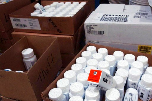 (AP Photo/Brian Branch-Price, File). FILE - In this Sept. 1, 2004, file photo, medical bottles bearing tracking codes in the McKesson medical distribution center in Delran, N.J. President Donald Trump has made big promises to reduce prescription drug c...