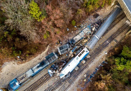 (AP Photo/Jeff Blake). The wreckage of an Amtrak train, bottom, and a CSX freight train lie next to the tracks in Cayce, SC., on Sunday, Feb. 4, 2018. The trains collided in the early morning darkness Sunday, killing the Amtrak conductor and engineer, ...