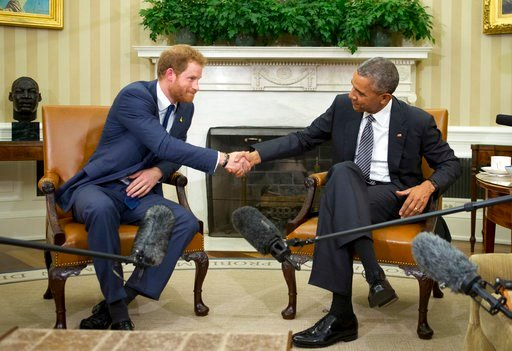 (AP Photo/Manuel Balce Ceneta, FILE). FILE- In this file photo dated Wednesday, Oct. 28, 2015, U.S. President Barack Obama, right, and Britain's Prince Harry, shake hands in the Oval Office of the White House in Washington, as Prince Harry is working o...