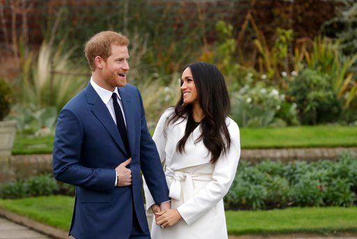 (AP Photo/Matt Dunham, FILE). FILE - In this file photo dated  Monday Nov. 27, 2017, Britain's Prince Harry and his fiancee Meghan Markle pose for photographers in the grounds of Kensington Palace in London, following the announcement of their engageme...