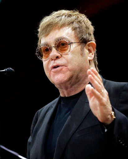 (AP Photo/Steven Senne, FILE). FILE - In this file photo dated  Monday, Nov. 6, 2017, musician Elton John addresses an audience before being presented with the 2017 Harvard Humanitarian of the Year Award on the campus of Harvard University, in Cambridg...