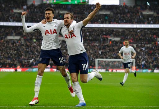 (AP Photo/Matt Dunham). Tottenham Hotspur's Harry Kane right, celebrates with teammate Tottenham Hotspur's Dele Alli after he scored the opening goal of the game during the English Premier League soccer match between Tottenham Hotspur and Arsenal at We...