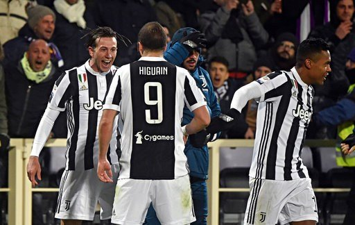 (Maurizio Degl'Innocenti/ANSA via AP). Juventus' Federico Bernardeschi, left, celebrates with teammate Gonzalo Higuain after scoring during a Serie A soccer match between Fiorentina and Juventus at the Artemio Franchi stadium in Florence, Italy, Friday...