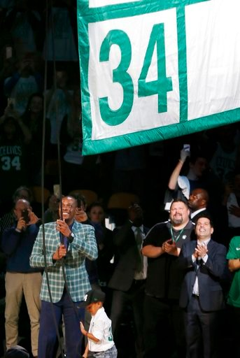 (AP Photo/Michael Dwyer). Former Boston Celtics Paul Pierce, left, raises a banner during a ceremony to retire his number following an NBA basketball game against the Cleveland Cavaliers in Boston, Sunday, Feb. 11, 2018.