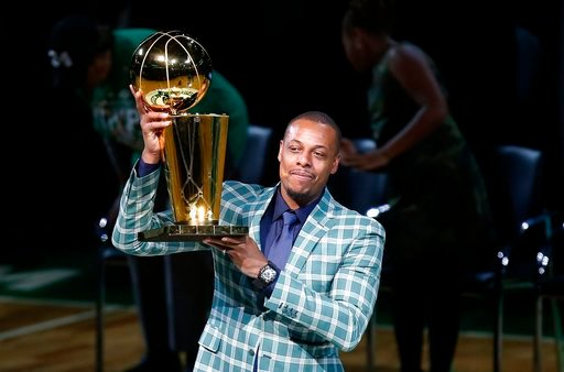 (AP Photo/Michael Dwyer). Former Boston Celtics Paul Pierce holds the NBA championship trophy that he won with the team during a ceremony to retire his number following a basketball game against the Cleveland Cavaliers in Boston, Sunday, Feb. 11, 2018.