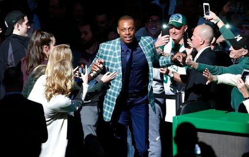 (AP Photo/Michael Dwyer). Former Boston Celtics Paul Pierce comes onto the court during a ceremony to retire his number following an NBA basketball game against the Cleveland Cavaliers in Boston, Sunday, Feb. 11, 2018.