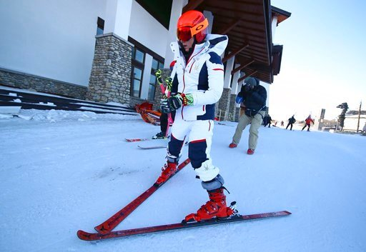 (AP Photo/Alessandro Trovati). United States' MikaelaShiffrin leaves the course after the women's giant slalom was postponed due to high winds at the 2018 Winter Olympics at the Yongpyong Alpine Center, Pyeongchang, South Korea, Monday, Feb. 12, 2018.