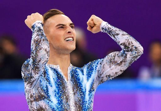 (Paul Chiasson/The Canadian Press via AP). Adam Rippon of the United States reacts after his performance in the men's single skating free skating in the Gangneung Ice Arena at the 2018 Winter Olympics in Gangneung, South Korea, Monday, Feb. 12, 2018.