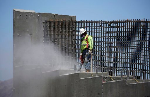 (AP Photo/John Locher, File). In this May 19, 2017, file photo, a man works on the Southern Nevada portion of U.S. Interstate 11 near Boulder City, Nev.