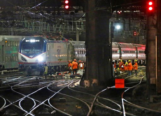 (AP Photo/Kathy Willens, File). In this July 9, 2017, file photo, Amtrak workers continue ongoing infrastructure renewal work beneath Penn Station in New York.