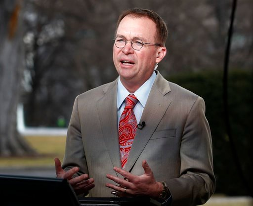 (AP Photo/Carolyn Kaster, File). File- This Jan. 22, 2018, file photo shows Director of the Office of Management and Budget Mick Mulvaney talking during a television interview outside the White House in Washington. Mulvaney, the former tea party congre...