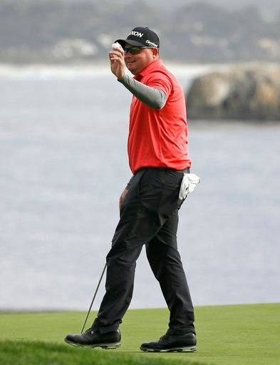 (AP Photo/Eric Risberg). Ted Potter Jr. holds up his ball on the 18th green of the Pebble Beach Golf Links after winning the AT&T Pebble Beach National Pro-Am golf tournament Sunday, Feb. 11, 2018, in Pebble Beach, Calif.