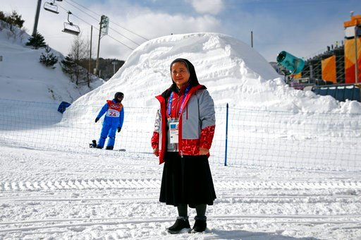 (AP Photo/Patrick Semansky). In this Feb. 12, 2018 photo, Sungsook Kim, a Catholic nun who goes by her religious name, Sister Droste, poses for a photograph at Phoenix Snow Park during the 2018 Winter Olympics in Pyeongchang, South Korea. Droste runs s...
