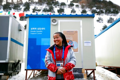 (AP Photo/Patrick Semansky). In this Feb. 12, 2018 photo, Sungsook Kim, a Catholic nun who goes by her religious name, Sister Droste, poses for a photograph outside her trailer office, the Gender Equality Support Centre, at Phoenix Snow Park during the...