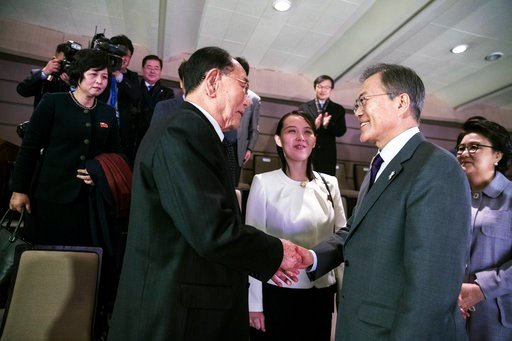 (Presidential Blue House via AP). In this photo provided by South Korea Presidential Blue House, South Korean President Moon Jae-in, right, shakes hands with North Korea's nominal head of state Kim Yong Nam as Kim Yo Jong, center, North Korean leader K...