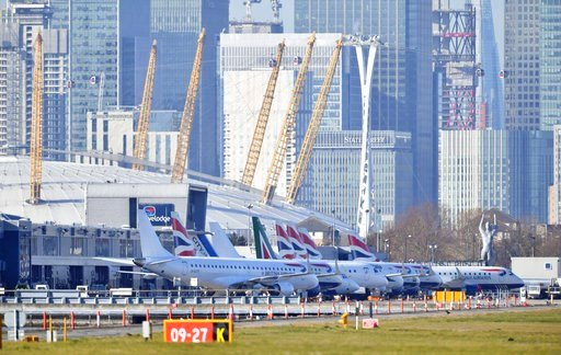 (Dominic Lipinski/PA via AP). Planes on the apron at London City Airport which has been closed after the discovery of an unexploded Second World War bomb was found in the nearby River Thames, Monday Feb. 12, 2018.