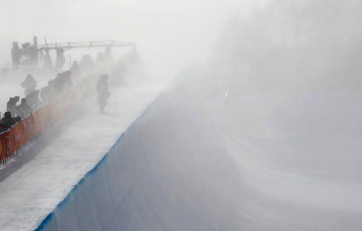 (AP Photo/Gregory Bull). Wind gust engulfs the half pipe course during the women's halfpipe qualifying at Phoenix Snow Park at the 2018 Winter Olympics in Pyeongchang, South Korea, Monday, Feb. 12, 2018.