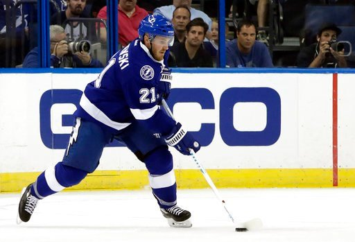 (AP Photo/Chris O'Meara, File). FILE - In this Sept. 27, 2016, file photo, Tampa Bay Lightning defenseman James Wisniewski (21) skates with the puck during the first period of an NHL preseason hockey game against the Carolina Hurricanes in Tampa, Fla. ...