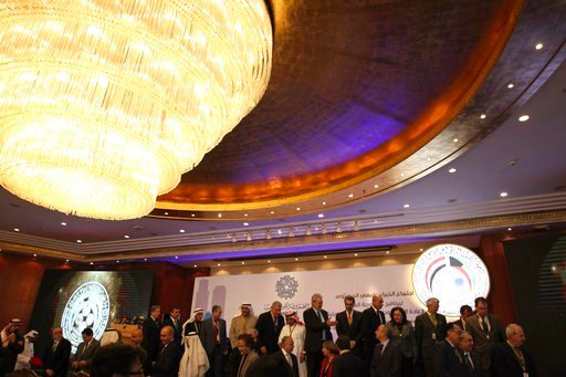 (AP Photo/Jon Gambrell). Officials leave the stage at conference on Iraq being held in Kuwait City, Kuwait, Monday, Feb. 12, 2018. Kuwait this week is hosting a series of conferences on rebuilding Iraq after the onslaught of the Islamic State group.