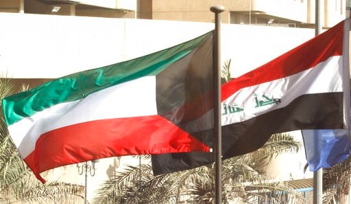 (AP Photo/Jon Gambrell). The flags of Kuwait, left, and Iraq, right, fly outside of a conference on Iraq in Kuwait City, Kuwait, Monday, Feb. 12, 2018. Kuwait this week is hosting a series of conferences on rebuilding Iraq after the onslaught of the Is...