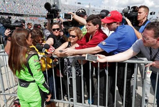 (AP Photo/John Raoux). Danica Patrick, front left, talks with members of the media during qualifying for the NASCAR Daytona 500 auto race at Daytona International Speedway, Sunday, Feb. 11, 2018, in Daytona Beach, Fla.