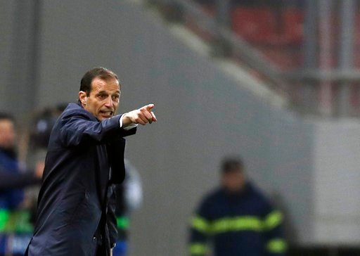 (AP Photo/Thanassis Stavrakis, file). FILE - In this Dec. 5, 2017 file photo, Juventus' coach Massimiliano Allegri gives directions to his players during the Champions League group D soccer match between Olympiakos and Juventus at Georgios Karaiskakis ...