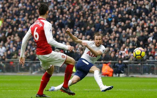 (AP Photo/Matt Dunham, files). FILE - In this Feb. 10, 2018 file photo, Tottenham Hotspur's Harry Kane, right takes a shot at goal during the English Premier League soccer match between Tottenham Hotspur and Arsenal at Wembley stadium in London. Totten...