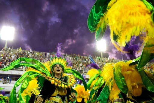 (AP Photo/Leo Correa). A performer from Mocidade samba school parades during Carnival celebrations at the Sambadrome in Rio de Janeiro, Brazil, Monday, Feb. 12, 2018.