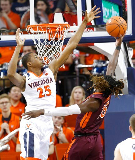 (AP Photo/Steve Helber). Virginia forward Mamadi Diakite (25) defends as Virginia Tech forward Chris Clarke (15) takes a shot during the second half of an NCAA college basketball game in Charlottesville, Va., Saturday, Feb. 10, 2018. Virginia Tech won ...