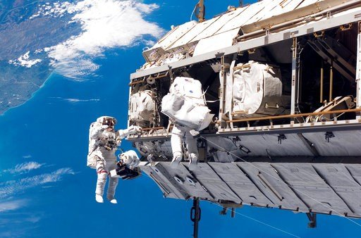(NASA via AP, File). FILE - In this Dec. 12, 2006, file photo, made available by NASA, astronaut Robert L. Curbeam Jr., left, and European Space Agency astronaut Christer Fuglesang, participate in a space walk during construction of the International S...