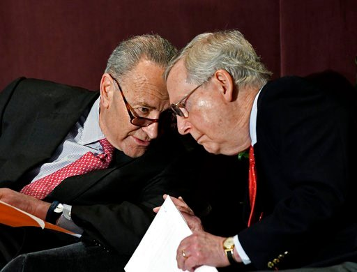 (AP Photo/Timothy D. Easley). Senate Minority Leader Charles Schumer, D-N.Y., left, leans in to speak to Senate Majority Leader Mitch McConnell, R-Ky., before his speech at the McConnell Center's Distinguished Speaker Series Monday, Feb. 12, 2018, in L...