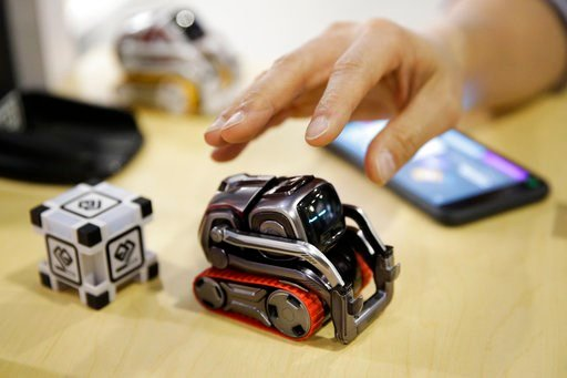 (AP Photo/Jae C. Hong, File). FILE- In this Jan. 10, 2018, file photo, Anki Cozmo coding robot is on display at CES International in Las Vegas. Cozmo, which debuted in 2016, now comes with an app called Code Lab that allows kids to drag and drop blocks...