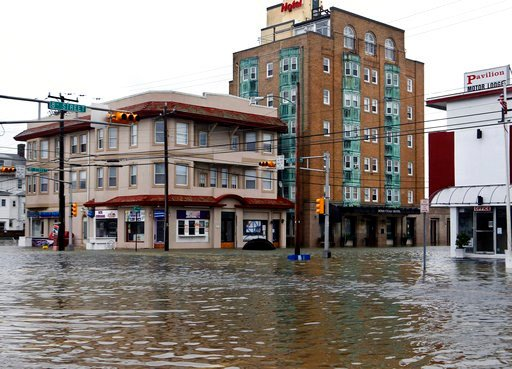 (AP Photo/Mel Evans, File). FILE - In this Oct. 30, 2012 file photo, the intersection of 8th Street and Atlantic Avenue is flooded in Ocean City, N.J., after the storm surge from Superstorm Sandy flooded much of the town. New satellite research shows t...