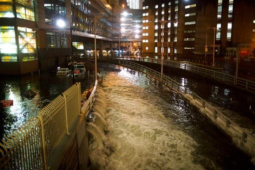 (AP Photo/ John Minchillo, File). FILE - In this Oct. 29, 2012, file photo, seawater floods the entrance to the Brooklyn Battery Tunnel in New York in the wake of Superstorm Sandy. New satellite research shows that global warming is making seas rise at...