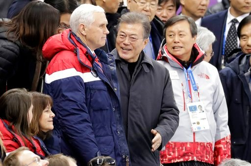 (AP Photo/Bernat Armangue). In this Feb. 10, 2018, photo,  Vice President Mike Pence, center left and South Korean President Moon Jae-in attend the ladies' 500 meters short-track speedskating in the Gangneung Ice Arena at the 2018 Winter Olympics in Ga...