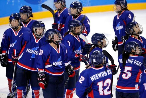 (AP Photo/Julio Cortez). Players of the combined Koreas react after the preliminary round of the women's hockey game against Sweden at the 2018 Winter Olympics in Gangneung, South Korea, Monday, Feb. 12, 2018. Sweden won 8-0.