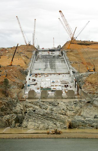 (AP Photo/Rich Pedroncelli, file). FILE - This Oct. 19, 2017 file photo shows repair work on the damaged main spillway of the Oroville Dam in Oroville, Calif. One year after the closest thing to disaster at a major U.S. dam in a generation, federal dam...