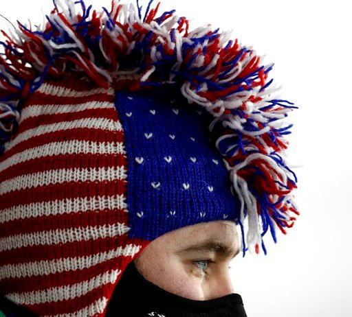 (AP Photo/Charlie Riedel). A United States fan watches the men's 12.5-kilometer biathlon pursuit at the 2018 Winter Olympics in Pyeongchang, South Korea, Monday, Feb. 12, 2018.