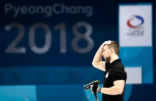 (AP Photo/Aaron Favila). Russian athletes Aleksandr Krushelnitckii react during their mixed doubles curling semi-final match against Switzerland at the 2018 Winter Olympics in Gangneung, South Korea, Monday, Feb. 12, 2018. Switzerland won.